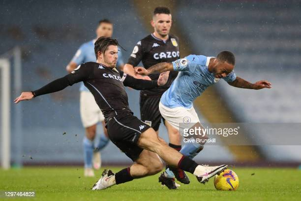 Raheem Sterling of Manchester City is tackled by Jack Grealish of Aston Villa during the Premier League match between Manchester City and Aston Villa...