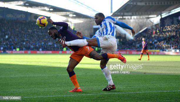 Raheem Sterling of Manchester City is tackled by Jason Puncheon of Huddersfield during the Premier League match between Huddersfield Town and...