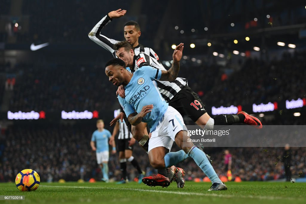 Raheem Sterling of Manchester City is tackled by Javi Manquillo of Newcastle United and a penalty is awarded during the Premier League match between Manchester City and Newcastle United at Etihad Stadium on January 20, 2018 in Manchester, England.