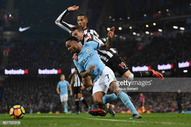 Raheem Sterling of Manchester City is tackled by Javi Manquillo of Newcastle United and a penalty is awarded during the Premier League match between...