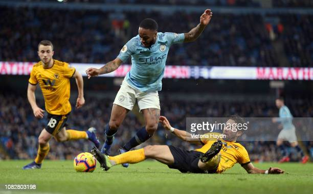 Raheem Sterling of Manchester City is tackled by Joao Moutinho of Wolverhampton Wanderers during the Premier League match between Manchester City and...