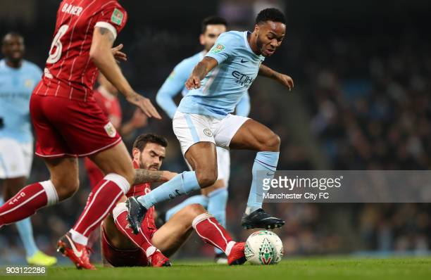 Raheem Sterling of Manchester City is tackled by Marlon Pack of Bristol City during the Carabao Cup SemiFinal First Leg between Manchester City and...