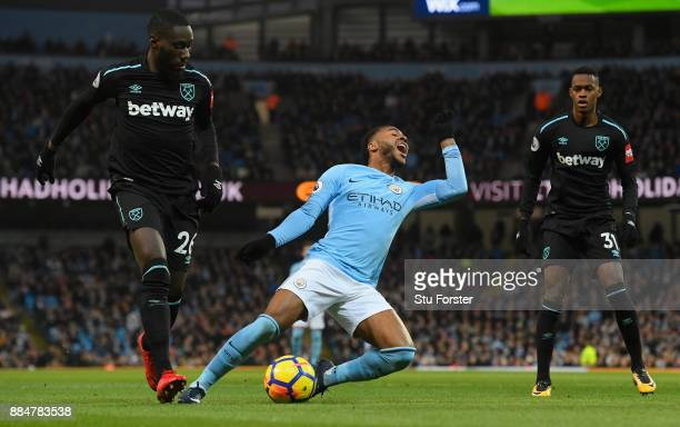 Raheem Sterling of Manchester City is tackled inside the box during the Premier League match between Manchester City and West Ham United at Etihad...
