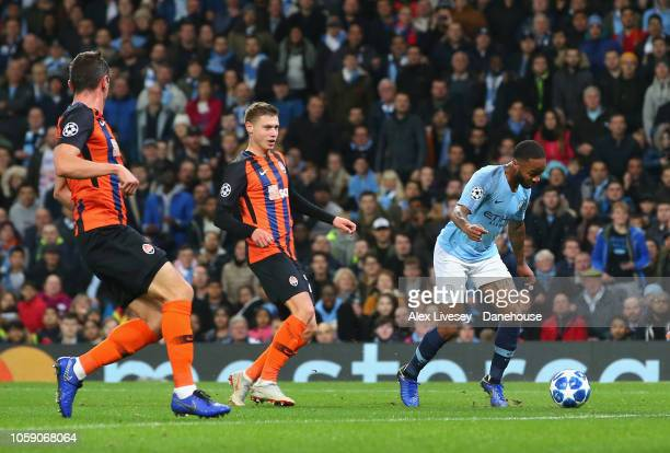 Raheem Sterling of Manchester City kicks the turf and trips over to be awarded a penalty during the UEFA Champions League Group F match between...