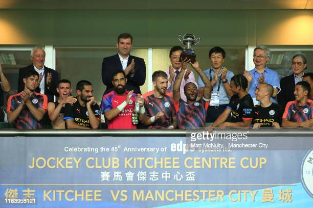 Raheem Sterling of Manchester City lifts a trophy after the Pre-Season friendly match between Kitchee and Manchester City at the Hong Kong Stadium on...