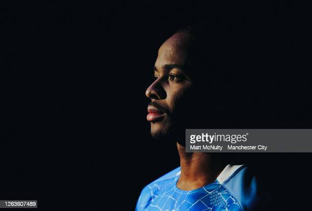 Raheem Sterling of Manchester City poses wearing the 2020/21 Puma home jersey at the City Football Academy on August 03 2020 in Manchester England