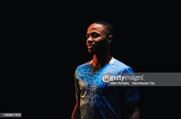 Raheem Sterling of Manchester City poses wearing the 2020/21 Puma home jersey at the City Football Academy on August 03, 2020 in Manchester, England.