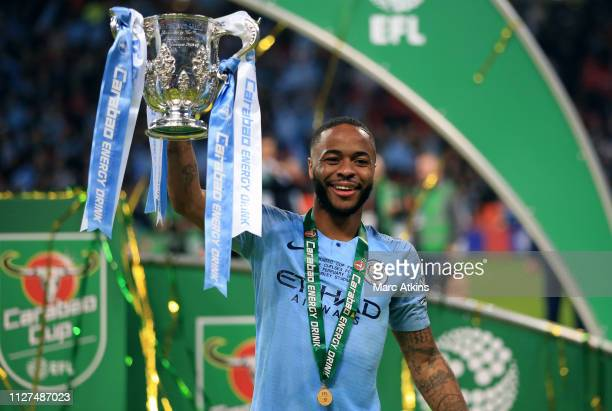 Raheem Sterling of Manchester City poses with the trophy during the Carabao Cup Final between Chelsea and Manchester City at Wembley Stadium on...