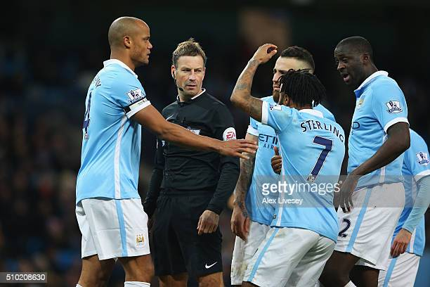 Raheem Sterling of Manchester City protests with referee Mark Clattenburg after he awarded a penalty for his hand ball during the Barclays Premier...