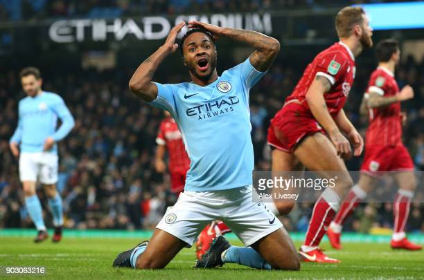 Raheem Sterling of Manchester City reacts after a miss during the Carabao Cup SemiFinal First Leg match between Manchester City and Bristol City at...