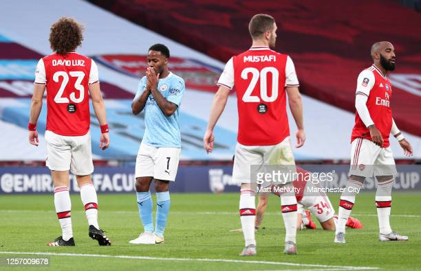 Raheem Sterling of Manchester City reacts after missing a chance during the FA Cup Semi Final match between Arsenal and Manchester City at Wembley...