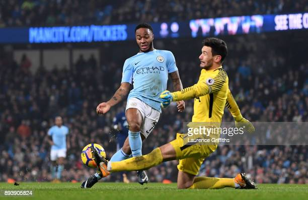 Raheem Sterling of Manchester City round Hugo Lloris of Tottenham Hotspur to score his sides fourth goal during the Premier League match between...