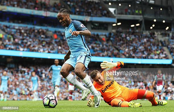 Raheem Sterling of Manchester City rounds goalkeeper Adrian of West Ham United to score his second goal and his team's third during the Premier...