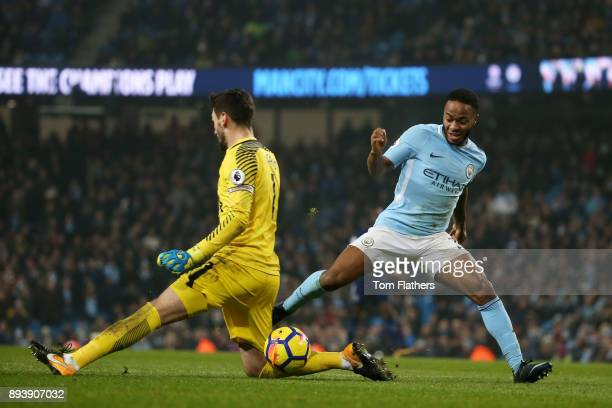 Raheem Sterling of Manchester City rounds Hugo Lloris of Tottenham Hotspur to score his sides fourth goal during the Premier League match between...