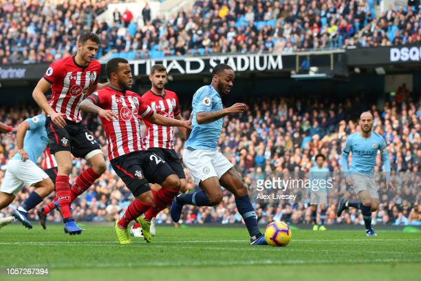 Raheem Sterling of Manchester City runs with the ball under pressure from Ryan Bertrand and Wesley Hoedt of Southampton during the Premier League...