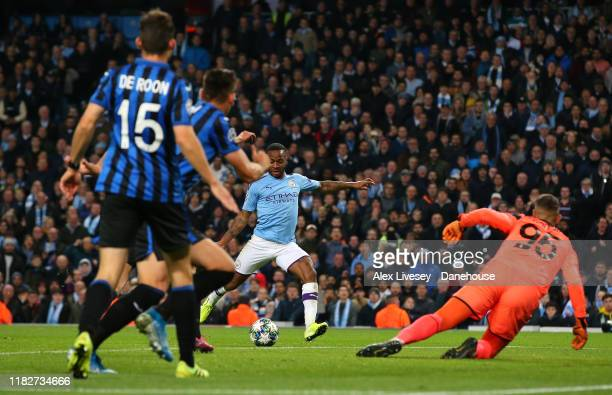 Raheem Sterling of Manchester City scores his first goal during the UEFA Champions League group C match between Manchester City and Atalanta at...
