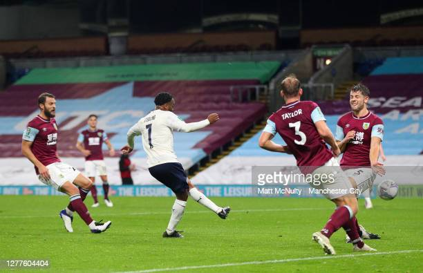 Raheem Sterling of Manchester City scores his sides first goal during the Carabao Cup fourth round match between Burnley and Manchester City at Turf...