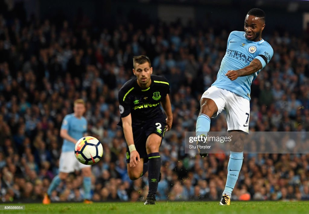 Raheem Sterling of Manchester City scores his sides first goal during the Premier League match between Manchester City and Everton at Etihad Stadium on August 21, 2017 in Manchester, England.