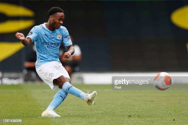 Raheem Sterling of Manchester City scores his sides second goal from the penalty spot during the Premier League match between Watford FC and...