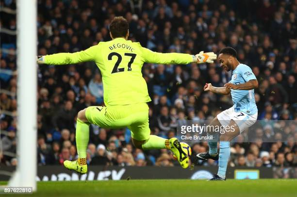 Raheem Sterling of Manchester City scores his sides second goal past Asmir Begovic of AFC Bournemouth during the Premier League match between...