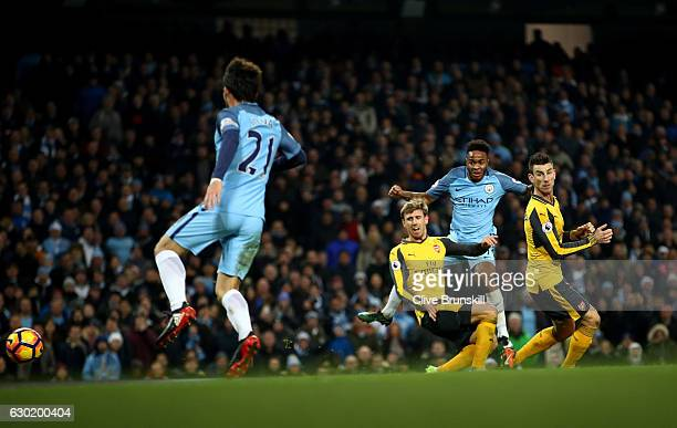 Raheem Sterling of Manchester City scores his sides second goal during the Premier League match between Manchester City and Arsenal at the Etihad...