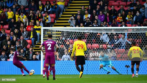Raheem Sterling of Manchester City scores his sides sixth goal past Heurelho Gomes of Watford during the Premier League match between Watford and...