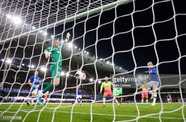Raheem Sterling of Manchester City scores his sides third goal during the Premier League match between Everton FC and Manchester City at Goodison...