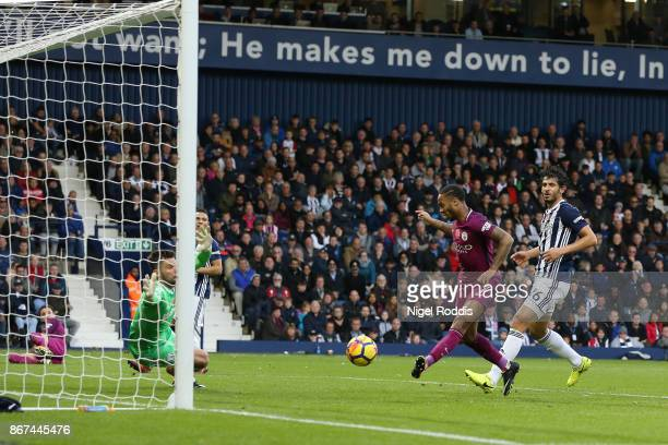 Raheem Sterling of Manchester City scores his sides third goal during the Premier League match between West Bromwich Albion and Manchester City at...
