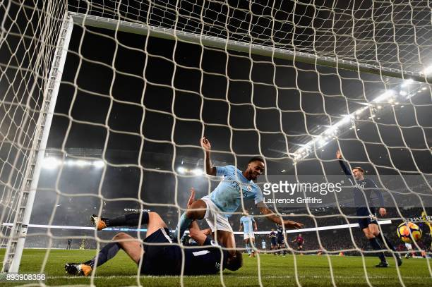 Raheem Sterling of Manchester City scores his sides third goal during the Premier League match between Manchester City and Tottenham Hotspur at...