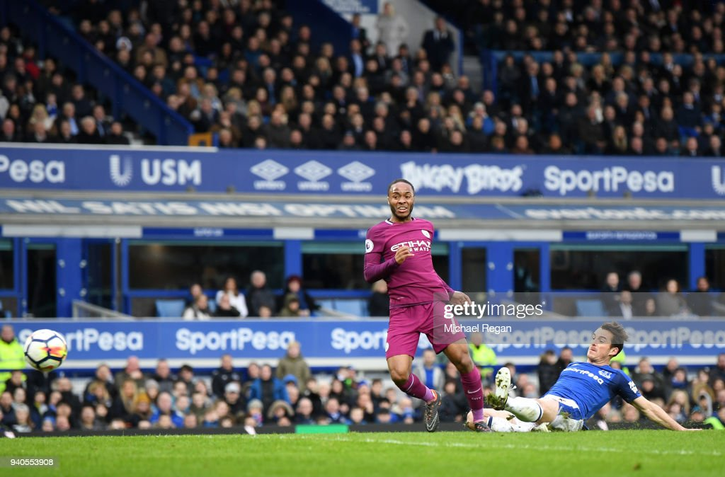 Raheem Sterling of Manchester City scores his sides third goal during the Premier League match between Everton and Manchester City at Goodison Park on March 31, 2018 in Liverpool, England.