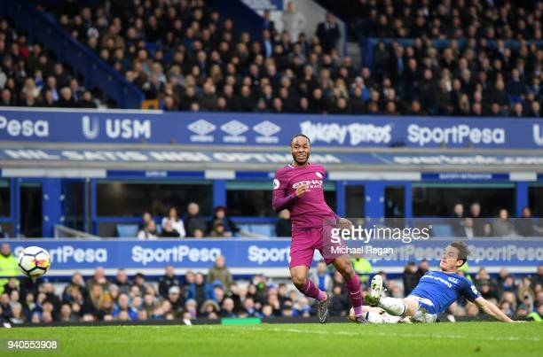 Raheem Sterling of Manchester City scores his sides third goal during the Premier League match between Everton and Manchester City at Goodison Park...