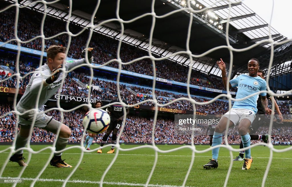 Raheem Sterling of Manchester City scores his sides third goal past Wayne Hennessey of Crystal Palace during the Premier League match between Manchester City and Crystal Palace at Etihad Stadium on September 23, 2017 in Manchester, England.