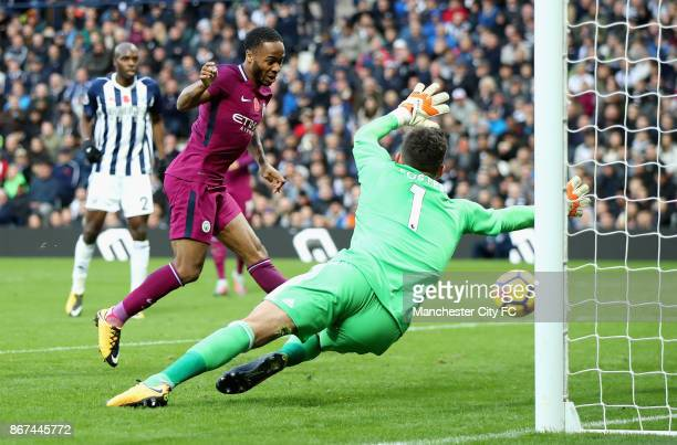 Raheem Sterling of Manchester City scores his sides third goal past Ben Foster of West Bromwich Albion during the Premier League match between West...