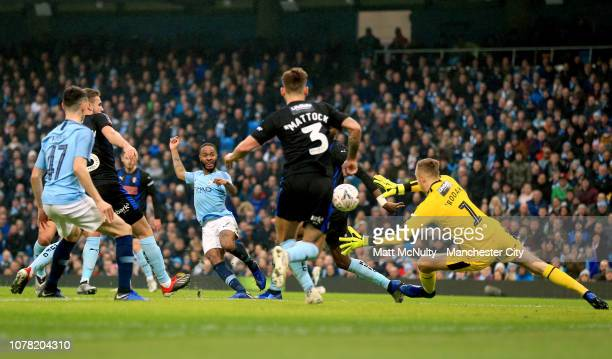 Raheem Sterling of Manchester City scores his team's first goal during the FA Cup Third Round match between Manchester City and Rotherham United at...