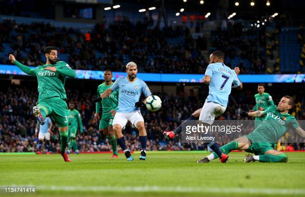 Raheem Sterling of Manchester City scores his team's first goal during the Premier League match between Manchester City and Watford FC at Etihad...