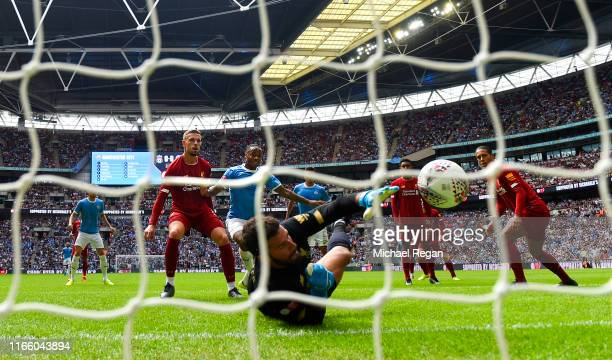Raheem Sterling of Manchester City scores his team's first goal during the FA Community Shield match between Liverpool and Manchester City at Wembley...