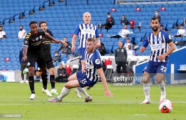 Raheem Sterling of Manchester City scores his team's first goal during the Premier League match between Brighton & Hove Albion and Manchester City at...