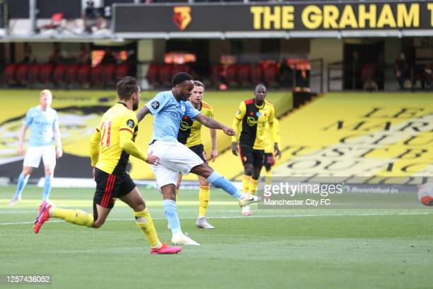 Raheem Sterling of Manchester City scores his teams first goal during the Premier League match between Watford FC and Manchester City at Vicarage...