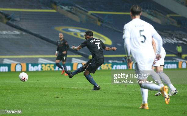 Raheem Sterling of Manchester City scores his team's first goal during the Premier League match between Leeds United and Manchester City at Elland...
