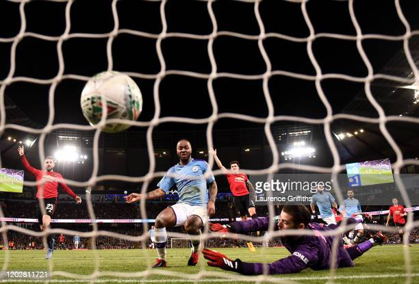 Raheem Sterling of Manchester City scores his team's first goal past David De Gea of Manchester United which is then disallowed for offside during...