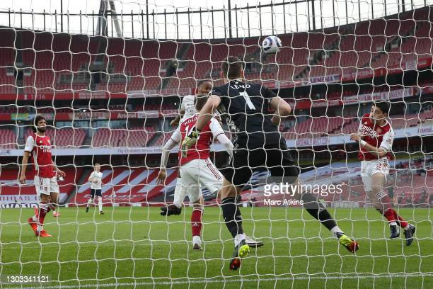 Raheem Sterling of Manchester City scores his team's first goal past Bernd Leno of Arsenal during the Premier League match between Arsenal and...