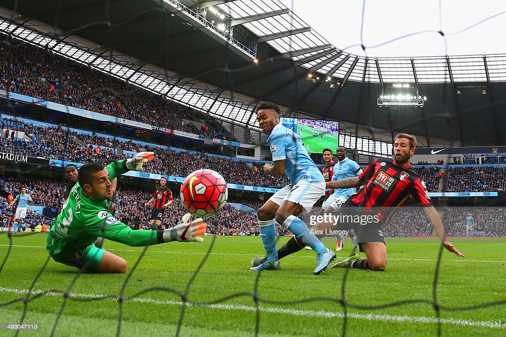 Raheem Sterling of Manchester City scores his team's first goal past Adam Federici of Bournemouth during the Barclays Premier League match between Manchester City and A.F.C. Bournemouth at Etihad Stadium on October 17, 2015 in Manchester, England.