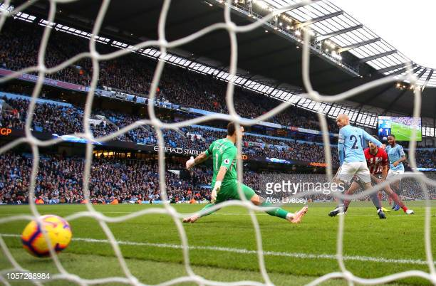 Raheem Sterling of Manchester City scores his team's fourth goal past Alex McCarthy of Southampton during the Premier League match between Manchester...