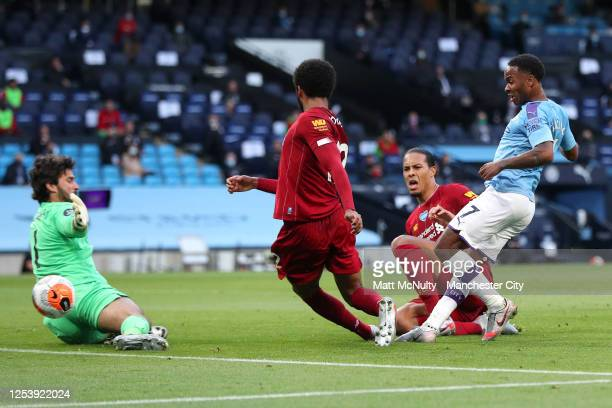 Raheem Sterling of Manchester City scores his team's second goal past Alisson Becker of Liverpool as he is challenged by Joe Gomez and Virgil van...