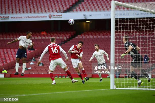 Raheem Sterling of Manchester City scores his team's second goal past Bernd Leno of Arsenal during the Premier League match between Arsenal and...
