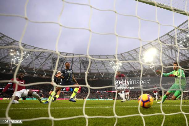 Raheem Sterling of Manchester City scores his team's second goal during the Premier League match between West Ham United and Manchester City at...