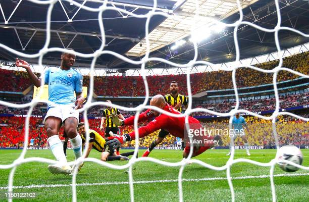 Raheem Sterling of Manchester City scores his team's sixth goal past Heurelho Gomes of Watford during the FA Cup Final match between Manchester City...