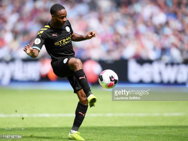 Raheem Sterling of Manchester City scores his team's third goal during the Premier League match between West Ham United and Manchester City at London...