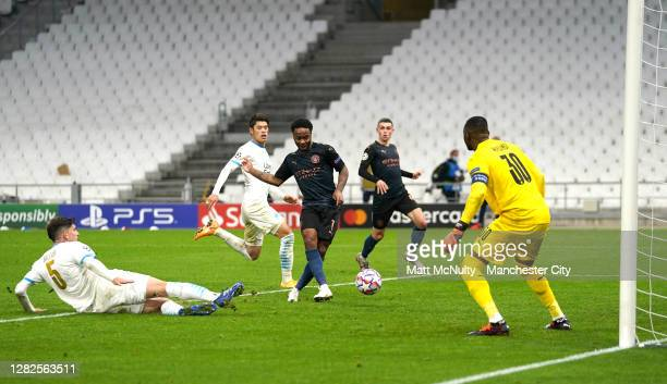 Raheem Sterling of Manchester City scores his team's third goal during the UEFA Champions League Group C stage match between Olympique de Marseille...