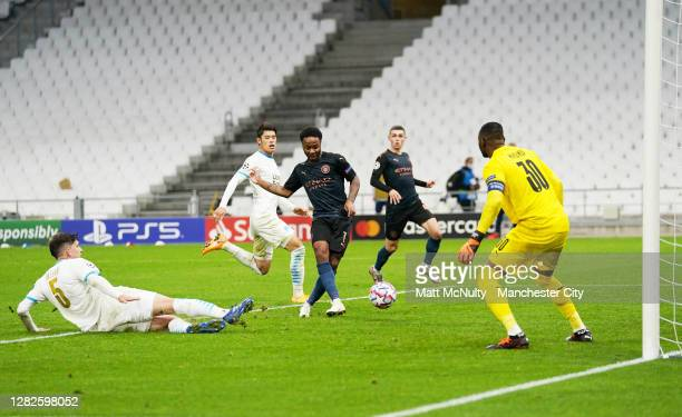 Raheem Sterling of Manchester City scores his teams third goal during the UEFA Champions League Group C stage match between Olympique de Marseille...